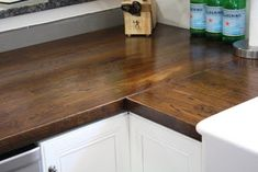 DIY -IKEA Oak Butcher Block stained with Minwax's Dark Walnut 2716  Waterlox low VOC sealer. This is what I'm going to have one day. White cabinets with butcher block countertops