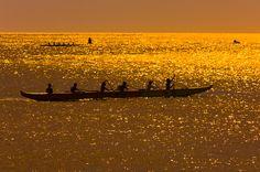 Outrigger canoes, Waialua Bay, off Hale'iwa Beach Park, Hale'iwa, North Shore, Oahu, Hawaii, USA.