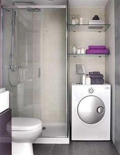 Small bathroom with toilet, glass shower room, laundry and shelving ideas in small apartment interior