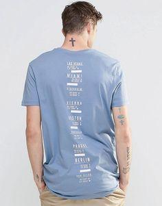 Imagen 1 de Camiseta larga con estampado de efecto columna vertebral en azul de ASOS