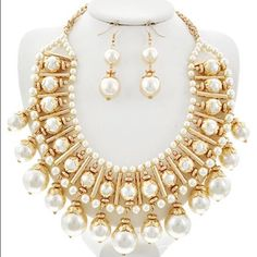 "Blissful Pearl Necklace Set Gold Tone / Cream Pearl  / Metal / Fish Hook (earrings) / Charm / Necklace & Earring Set •   ChiqStyle No : 00521006 •   LENGTH : 1/ 1/8"" + EXT •   EARRING : 2 3/8"" •   DROP : 2 5/8""  •   GOLD/CREAM Jewelry Necklaces"
