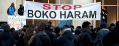 Men hold a banner in Paris to protest against extremist Islamic group Boko Haram. (Thibault Camus/AP)