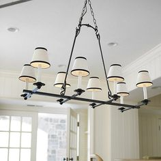 Laurel 8 Light Rectangular Chandelier $179.99.  this is a great price, brings in the black from the kitchen and ties both modern and traditional elements together.