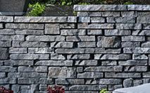 FlagStack® Wall System-Flagstack® is an authentic looking, versatile and easy to use landscape wall system that offers the appearance and character of a natural drystacked wall at a fraction of the cost of traditional flagstone wall.