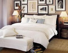 Gorgeous photo gallery wall above bed in master bedroom, super cute!