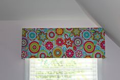 Make your own window valance using fabric and foam.