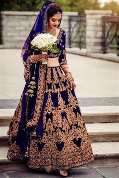 Wearing a blue bridal lehenga for your big day? These blue bridal lehengas will up your glamour quotient. The unique lehenga is in huge demand nowadays. Take cues from these designer lehenga. Lehenga Wedding, Bridal Lehenga Choli, Wedding Frocks, Indian Bridal Outfits, Bridal Dresses, Reception Dresses, Wedding Reception, Wedding Wear, Indian Dresses