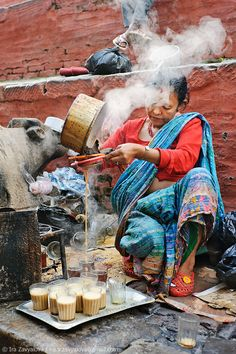 In Nepal division of labor by gender exists. Men are the ones that do the hard work and women are only expected to cook, wash and care for the children. This woman in the photo is preparing Masala tea, Durbar Square, Kathmandu, Nepal. We Are The World, People Around The World, Wonders Of The World, Around The Worlds, Voyage Nepal, Photo Trop Belle, Monte Everest, Masala Tea, The Chai