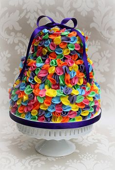 ruffled cake. Reminds me of the balloon bows