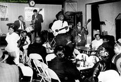 Howlin' Wolf (center) at Silvio's, 1964, with (l to r) Willie Young (sax), Cassell Burrow (drums), Hubert Sumlin (guitar), Johnny Jones (piano), Andrew McMahon (bass); photographer: Raeburn Flerlage