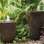 Bring serenity to your garden by adding an outdoor fountain. Beautiful sounds of water flowing from a fountain rains feelings of calmness washing over you. Outdoor Water Features, Water Features In The Garden, Diy Fountain, Front Yard Landscaping, Landscaping Ideas, Water Garden, Fish Garden, Planting Flowers, Garden Design