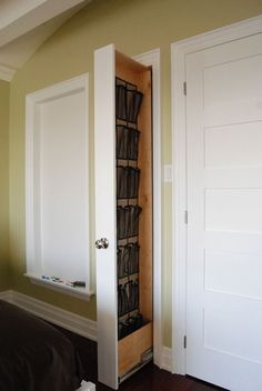 em's room extra space idea shoe storage ideas - hidden wall shoe organizer, via Hard Core Renos