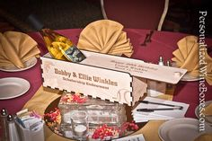 Here's a great idea for Charity Fundraising Events.  A SELF-FUNDED table centerpiece - a bottle of wine and a Personalized Wine Box with the charities LOGO and mission statement laser engraved. At the end of the evening, have each table conduct a not-so-silent auction for the Center Piece starting at a certain price. A little table competition could go a long ways toward underwriting some of the room décor. Prices starting at $45 plus shipping for the wood boxes.  (#wine not included!)