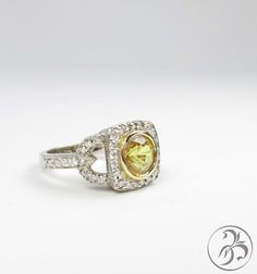 Unique engagement ring. 1.23ct yellow sapphire with diamond halo and unique diamond band. Sapphire is bezel set in yellow gold and the halo has a cushion shape.  Custom created by Redford Jewelers in Salt Lake City