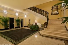 Sweeping: To get up to the glittering penthouse, next door to Bette Midler's home, the star would have to scale this vast marble staircase helped by a carved iron rail