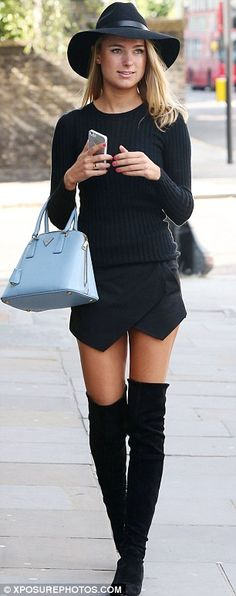 Secret smile: Kimberley Garner, who was on TV series Made In Chelsea smiled as she walked her regular haunt in an all-black ensemble adding a splash of colour with her powder blue Prada bag