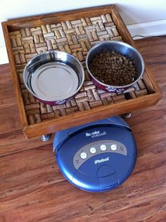 Roomba house and dog bowl holder