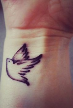 Tattoos are one of the best and most beautiful body art. There are two types of tattoos available fo Wrist Tattoos For Women, Tattoos For Women Small, Tattoos For Guys, Colorful Bird Tattoos, Small Bird Tattoos, Flower Tattoos, Tattoo Designs For Girls, Small Tattoo Designs, Tattoo Damen
