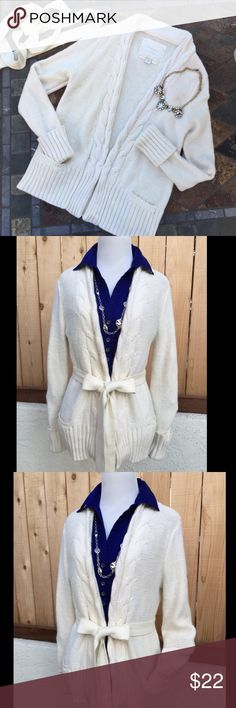 """Cream Knit Cardigan Beautiful cream color knit cardigan. It has long sleeves with a knit belt as seen in photos. In addition to two front pockets. Measures 19"""" wide pit to pit and 24.25"""" long from shoulder seam to bottom of sweater. Medium weight for layered warmth. Content is a comfy 52% Cotton, 20% Rayon & 18% Nylon. In excellent condition with NO spots or damage. Looks beautiful! American Eagle Outfitters Sweaters Cardigans"""