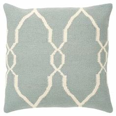 Showcasing a stylish trellis motif in antique-white, this handmade wool pillow adds a chic touch to your sofa or chaise.  Product: PillowConstruction Material: Wool coverColor: Antique white and blueFeatures: Hand-wovenCleaning and Care: Blot out stain as much as possible. Test fabric cleaner in discreet area. See manufacturer's label for further information.