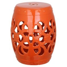 Showcasing a cutout design and eye-catching orange finish, this ceramic garden stool brings artful appeal to your home office or living room seating group.