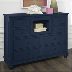 Why haven't I seriously entertained the notion of navy blue furniture before now? This is gorgeous!