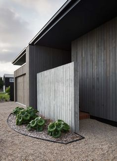 MRTN Architects's House Under Eave has a shifting scale - from the street it appears as a compact assemblage of parts, which rapidly expand upon entry.
