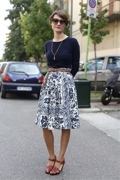 Florals don't have to be loud. Try a muted print with a navy long-sleeve top for a subdued chic summer look.