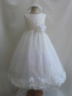 The dress is made of high quality satin fabric. The skirt has 4 layers, combination of tulle fabric and soft lining fabric. You are able to