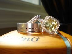 This is too cool! Citrine engagement ring, small yellow diamond stone in the husband's wedding band to match it.