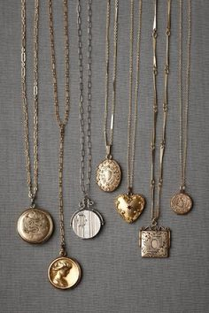 vintage lockets... Lately I've been into the idea of manly lockets. For family photos and such...frees up space in the wallet!