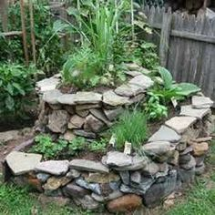I want this herb spiral in my garden!!! I love its rustic look.
