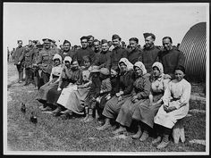 OFFICIAL PHOTOGRAPH TAKEN ON THE BRITISH WESTERN FRONT IN FRANCE. Spectators of some R.A.F. Sports.'