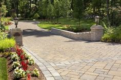 A custom driveway entrance featuring Techo Bloc paving bricks and Techo Bloc pillars with wing walls. A custom driveway entrance featuring Techo Bloc paving bricks and Techo Bloc pillars with wing walls. Brick Driveway, Driveway Entrance, Entrance Gates, House Entrance, Entrance Ideas, Driveway Ideas, Main Entrance, Hardscape Design, Driveway Lighting