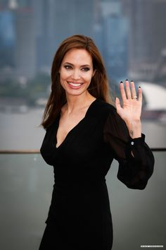 Angelina Jolie poses during a photocall as she takes part in a promotional tour for the film Maleficent in Shanghai June 3 2014.
