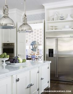 Visual Comfort pendants, white kitchen, marble countertops