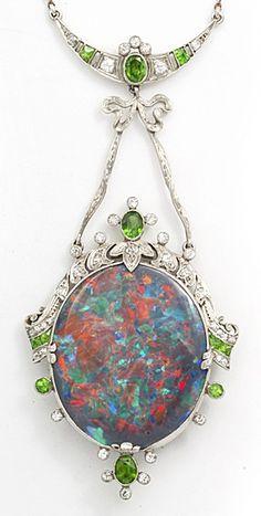 Art Deco Black Opal Pendant. Black opal, diamond, and demantoid garnet pendant mounted in platinum. American, 1925.