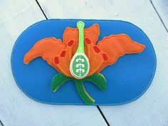 Teach children the parts of a lily! The Eco-Fi felt organs for this board are made in the USA from 100% post-consumer recycled bottles. Each puzzle piece contains three layers of felt offering a stiffer piece to withstand little ones. The board features a marine vinyl background and backing, extra stiff hidden stabilizer (think cardboard consistency), AND a nifty clear vinyl storage pocket on the back to keep all your little felt organs tidy. I decided to use all vinyl in this aspect…