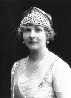 A lovely pearl and diamond belle epoque tiara worn here by Princess Alice, Countess of Athlone, sister-in-law to Queen Mary, granddaughter to Queen Victoria. To date this is the only image of this tiara, a stylised series of fronds, topped by pearls and rising from a band of substantial diamonds.