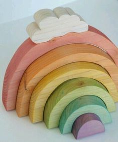 Pretty wooden toys Folk pull toy cows by Pretty Dreamer. Rainbow Stacker by Beneath the Rowan Tree Set of 3 Wooden Cars by The Wood Toy Shop Pink Helicopter by Birdy boots Colorful cups and balls by. Rainbow Baby, Over The Rainbow, Wooden Rainbow, Wooden Car, Wooden Blocks, Natural Toys, Natural Baby Products, Pull Toy, Montessori Toys