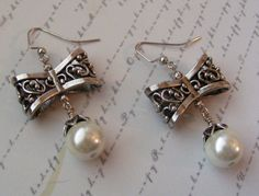 Bows are Coolsilver earrings with white pearls by MarteenysJewelry, $15.00