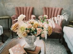 Beautiful lounge space and garden florals for a Netflix Bridgerton inspired wedding at Marigny Opera House in New Orleans. Overgrown florals, greenery columns and antique details. Lush garden flowers by Leaf + Petal NOLA, rentals by Lovegood Rentals, planning by Iris + Oak Events and photography by Peony Photography Garden Urns, Lush Garden, Antique Decor, Vintage Decor, Antique Books, Kings Table, Dendrobium Orchids, Spray Roses, Flower Centerpieces