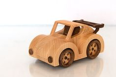 I made this fun Volkswagen Beetle Wooden Toy Car from beech and maple. Vehicle with rotating wheels. No nails or screws, just glue, natural linseed oil. All very child-safe. Jeep Wrangler, Wooden Car, Buy Toys, Cnc Projects, Vw Beetles, Wood Toys, Toy Boxes, Woodworking Crafts, Wood Crafts