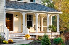 Like the yellow siding with white trim and lattice around the bottom.