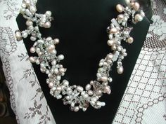 Una forma diferente de engarzar perlas con swaroskies y algo más....