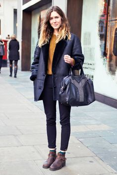 In London, a shearling coat, YSL bag, and flat boots work perfectly #streetstyle