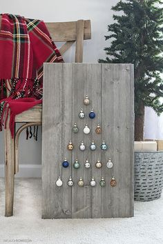 Step by step instructions on how to build a simple, rustic Shiplap Ornament Display. A great addition to your rustic, farmhouse holiday decor -- and you can change out the ornaments! http://livelaughrowe.com https://emfurn.com/