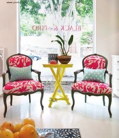 Otomi upholstered chairs from Black and Spiro. Loved the mixed patterns with with pillows.