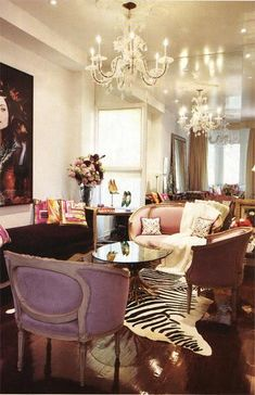 Dazzling and Eclectic living room. Purple, zebra hide, chandelier