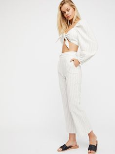 Haven Crop Set | American made striped set is featured in a luxe and lightweight linen-blend.    **Top:**   Adjustable tie in front   Cropped silhouette   Wide long sleeves with elastic cuffs   Elastic bands on the shoulders   **Pants:**   Cropped inseam   High rise   Flat front and back   Hip pockets   Hidden back zip closure